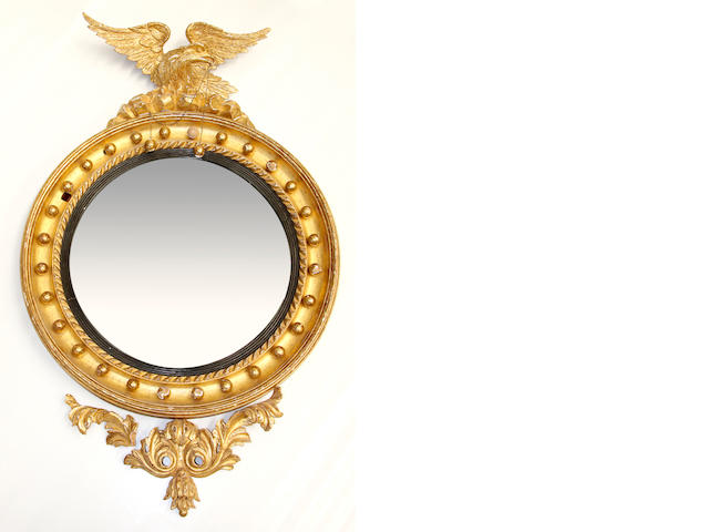A 19th Century giltwood and gilt gesso framed convex wall mirror