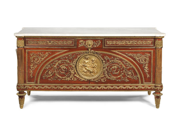 A French 20th century Louis XVI style gilt metal mounted mahogany commodeafter the model by Guillaume Benneman