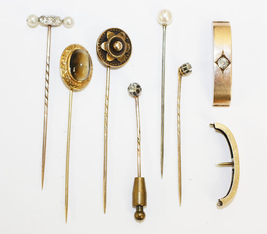 A diamond single stone scarf pin and six stickpins