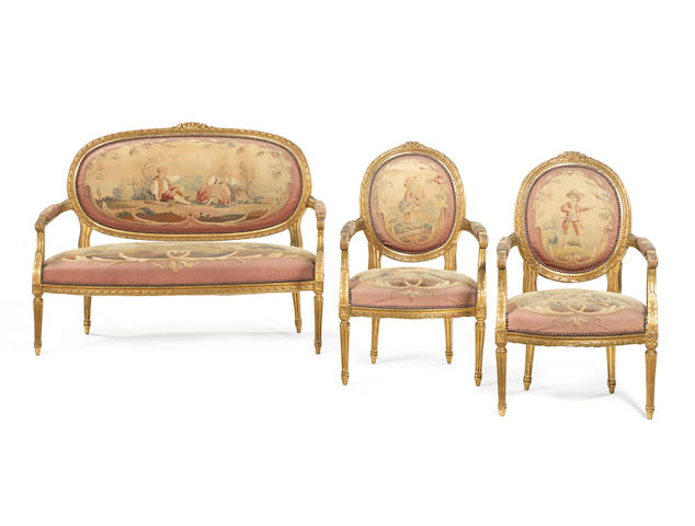 A French late 19th/ early 20th century giltwood and tapestry three-piece salon suite