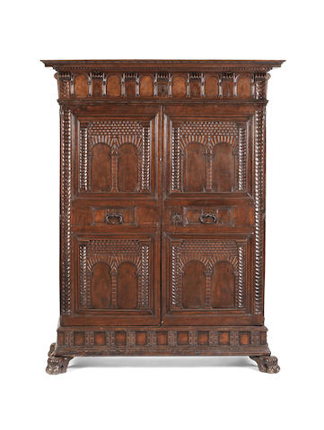 An Italian 19th century walnut architectural cabinet  incorporating earlier elements