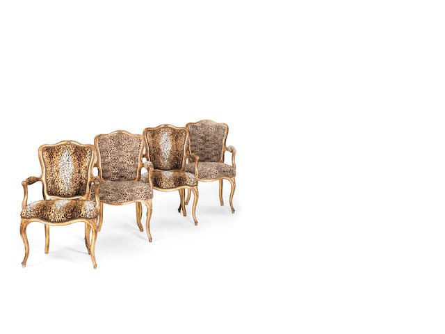 A set of four 19th century, Louis XV style, giltwood fauteuils en cabriolet retailed by Miles & Edwards, London