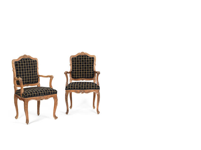 A pair of Italian walnut armchairs (damage and restorations)