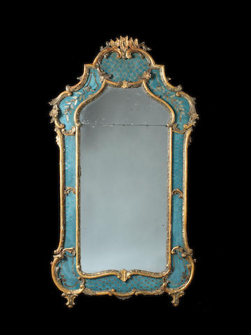 A Venitian 18th century rococo giltwood and églomisé blue and silver painted mirror