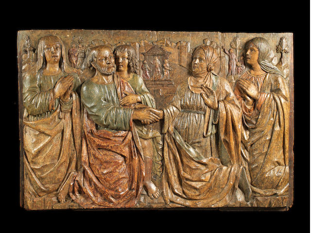 A North Italian / Lombard carved and polychrome decorated wood relief depicting the Encounter at the Golden Gate circa 1490