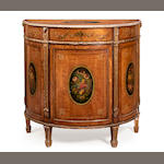 A George III style satinwood, parcel gilt and polychrome decorated demi-lune cabinet