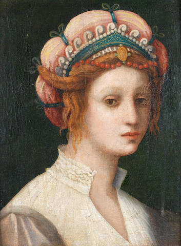 Attributed to Domenico Puligo (Florence 1492-1527) Portrait of a lady, bust-length, in classical costume