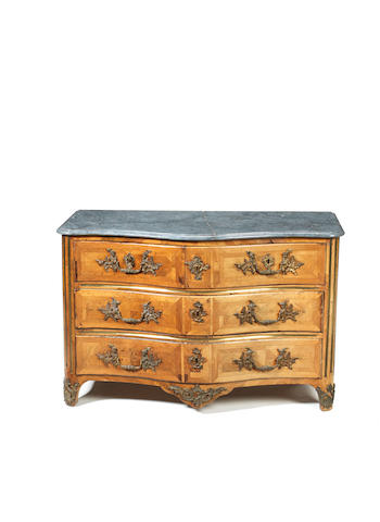 A French Régence ormolu and brass-mounted kingwood serpentine commode