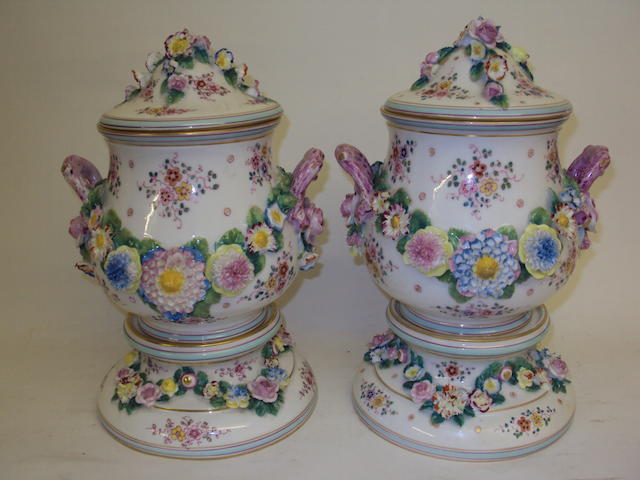 A pair of Continental porcelain urns on stands