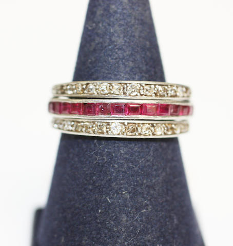 A ruby, sapphire and diamond swivel ring