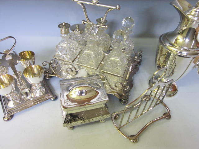 An electroplated four piece egg cruet,   (5)
