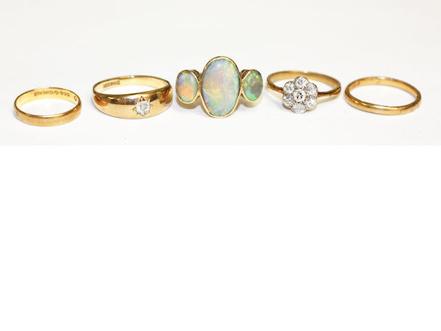 An opal three stone ring, (5)
