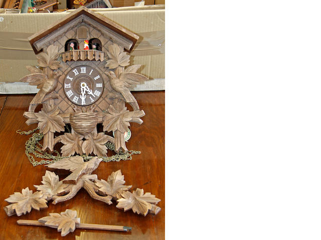 Three various cuckoo clocks, mid 20th Century, 3