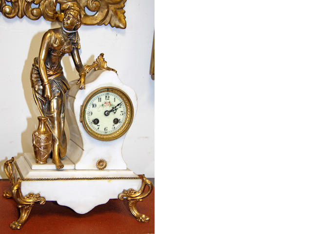 An early 20th century gilt metal and white marble figural mantle clock