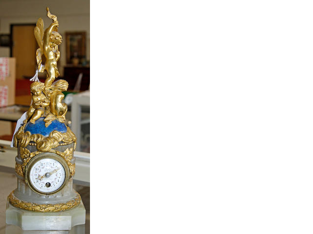 A 19th century French onyx and gilt metal mounted timepiece