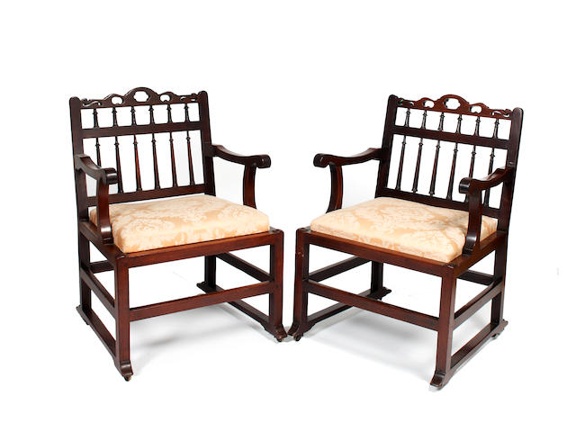 A pair of George III North Country mahogany armchairs