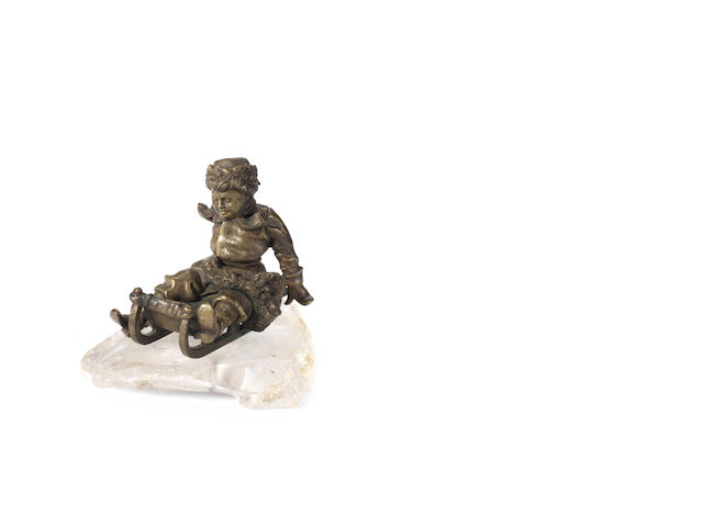 A Russian 19th century bronze of a boy on a sledge