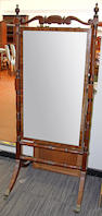 A George IV carved mahogany cheval mirror