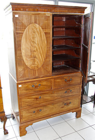 A late George III mahogany linen press