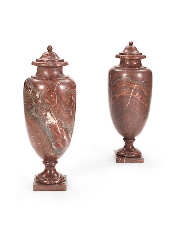 A pair of 20th century lidded red marble urns