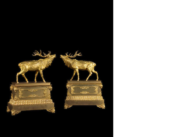 A large pair of 19th century gilt-bronze stags on plinths in the manner of Vulliamy