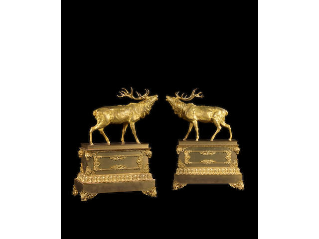A large pair of 19th century gilt-bronze stags on plinths