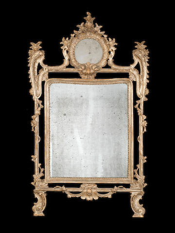 A pair of Neapolitan 18th century carved silvered-wood mirrors