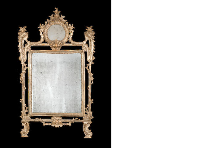 A pair of Italian 18th century carved silvered mirrors