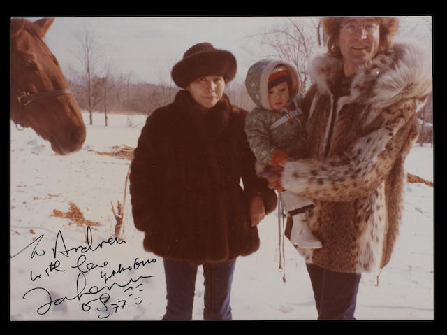 John Lennon & Yoko Ono: An autographed photograph of the couple in the snow with their son Sean,