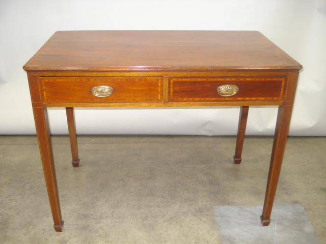 An Edwardian mahogany and satinwood banded canteen table