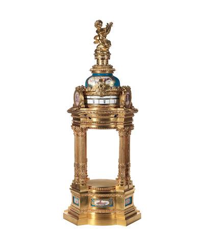 A late 19th century French porcelain mounted gilt brass annular dial clock Lenoir, Paris