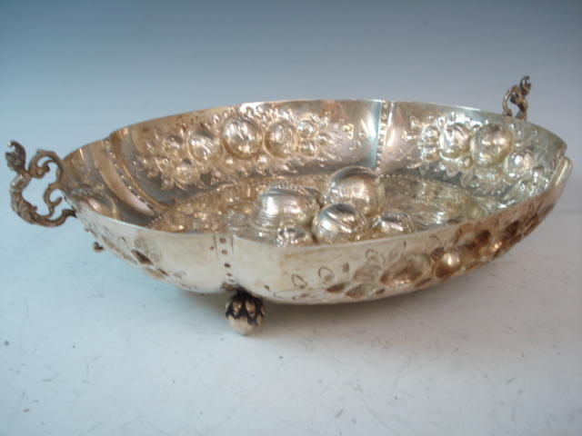 A 19th century Dutch silver two handled bowl with embossed decoration and inscribed