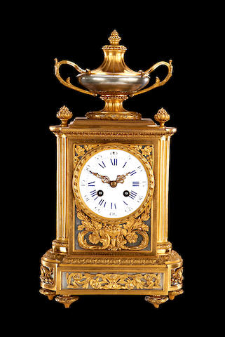 A late 19th century French gilt and silvered bronze mantel clock