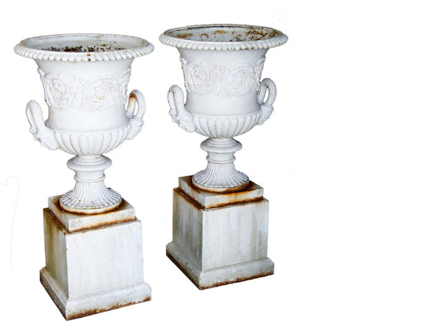 A pair of early 20th century cast iron campana urns