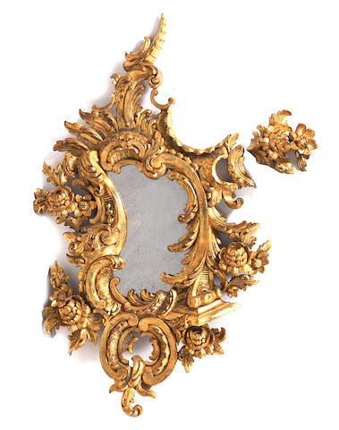A 19th century Continental giltwood, Rococo style, wall mirror