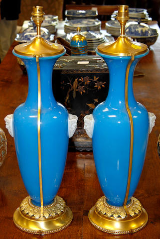 A pair of blue opaque glass and gilt metal mounted table lamps