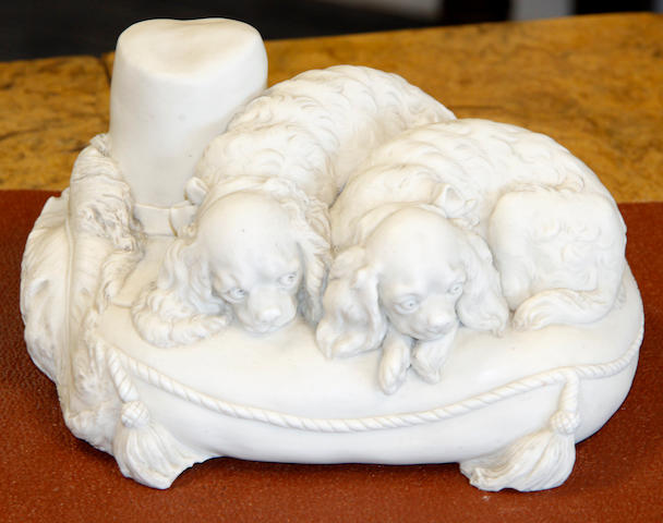 A Copeland Parian ware model of dogs on a cushion