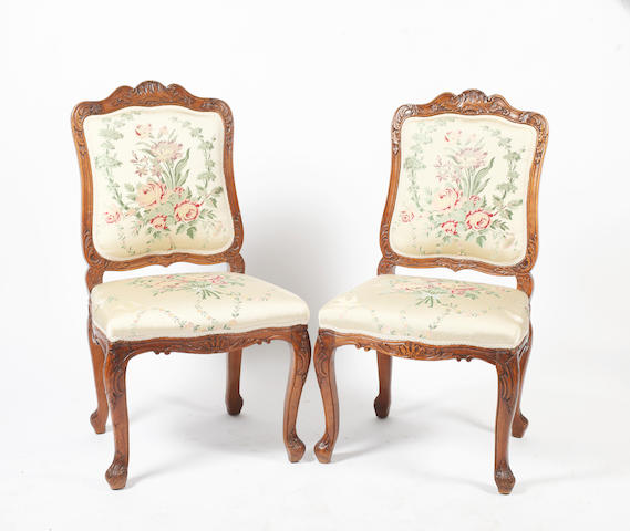 A set of eight 18th Century walnut side chairs, in Regence style