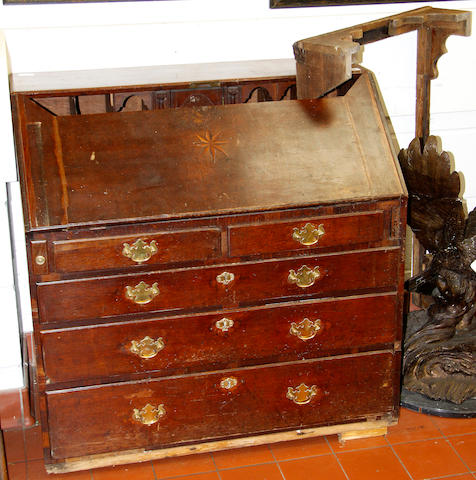 A George III oak bureau