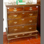 An early George III oak chest on low stand