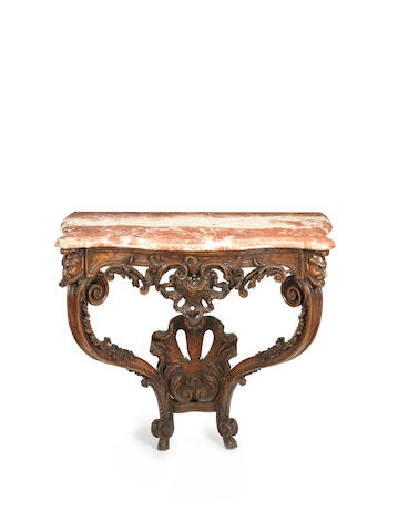 A French early 18th century Régence carved walnut console