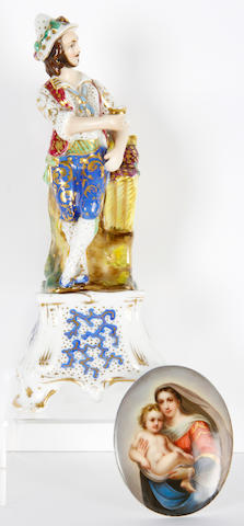 A Russian porcelain figure, an egg and a continental porcelain oval plaque