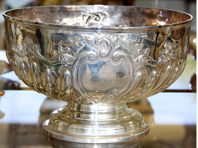 A silver circular punch bowl