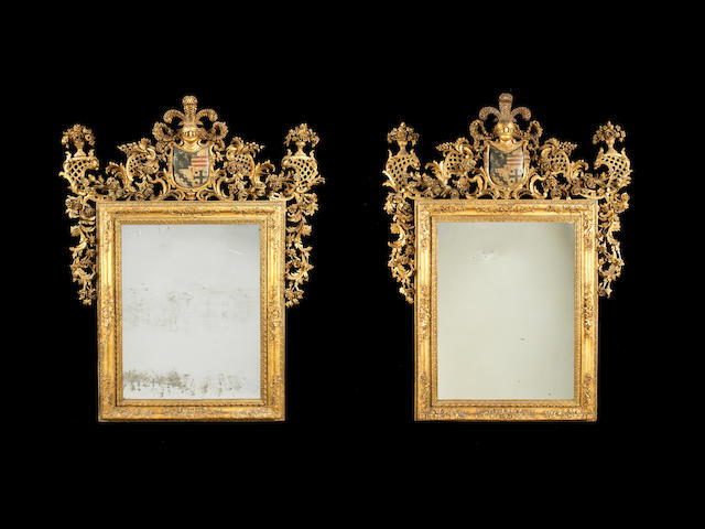 A pair of very important Venitian 18th century polychrome decorated giltwood framed mirrors
