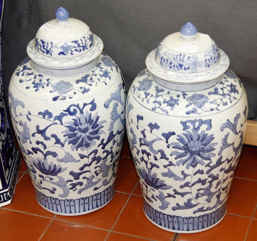 A pair of modern Chinese blue and white baluster vases and covers