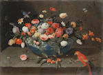 Studio of Jan van Kessel the Elder (Antwerp 1626-1679) A basket of grapes, plums and peaches, with a melon and a squirrel eating nuts on a stone ledge; and A wan-li kraak bowl filled with tulips, roses, narcissi and other flowers, (2).