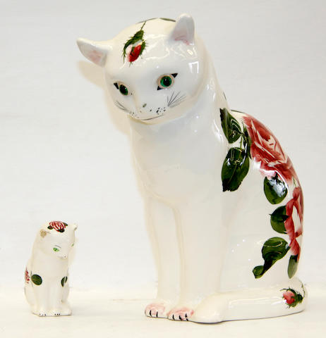 Two Plichta models of seated cats