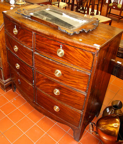 A George III mahogany bow fronted chest,