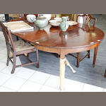 A George III style mahogany extending dining table,