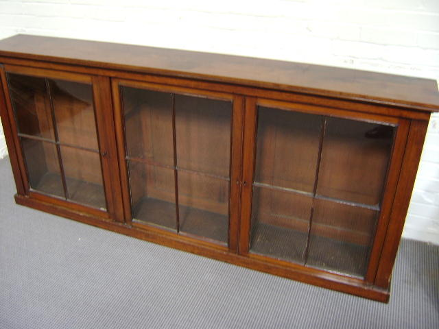 Victorian mahogany dwarf bookcase containing three glazed doors, 211cm wide and 95cm high